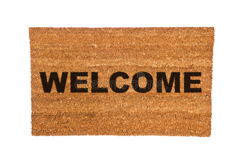 Doormat with Welcome Text. A new welcome doormat isolated on a white background stock photo