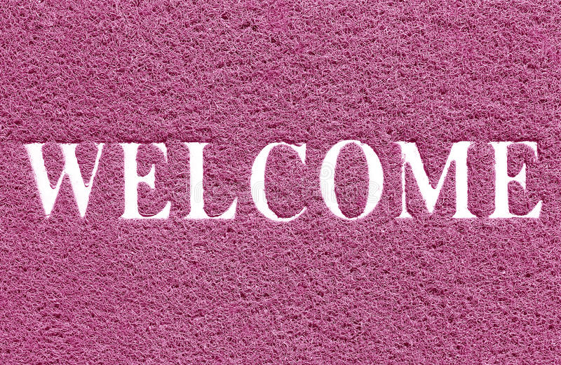 Doormat of welcome text on white background royalty free stock photo
