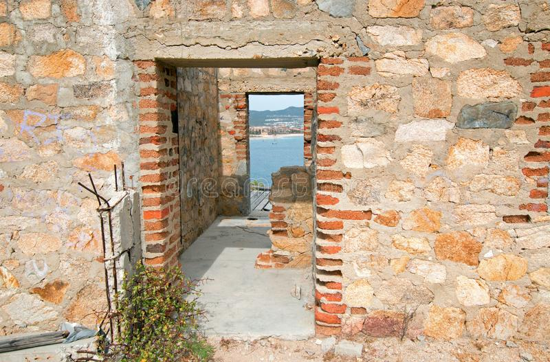 Doors at abandoned brick and stone building on hill above Cabo San Lucas marina and harbor in Baja California Mexico. Abandoned brick and stone building on hill royalty free stock photography