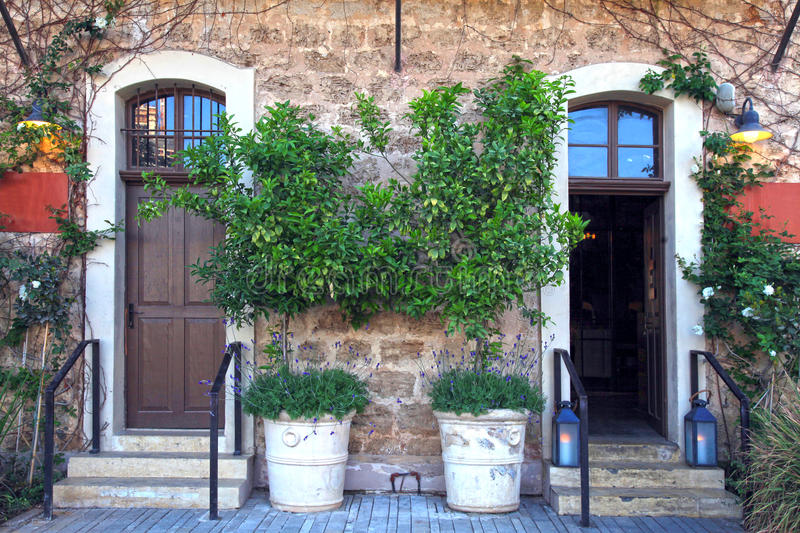 Download Doors, Plants And Flowers In A Traditional Stone Mediterranean H Stock Photo - Image of exterior, flower: 77451622