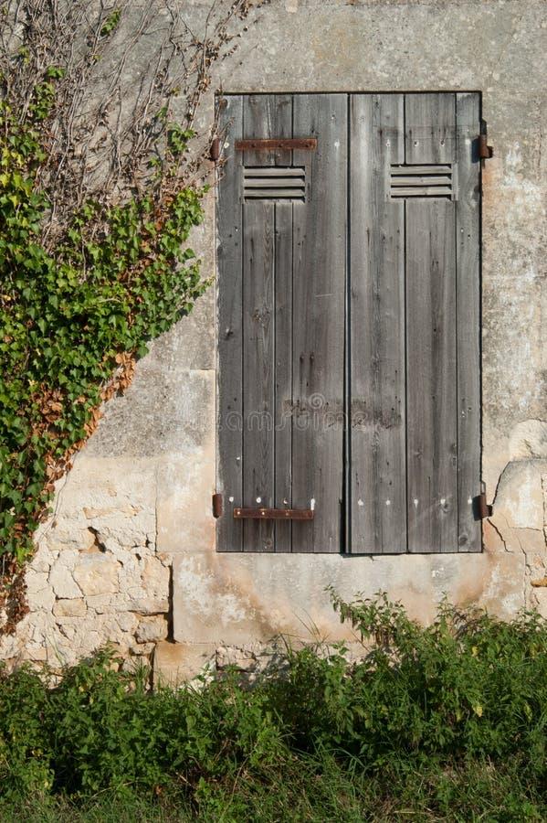 Doorstane Frans vensterblinden royalty-vrije stock foto's