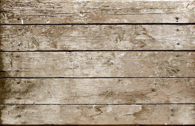 Doorstane houten planksepia stock foto