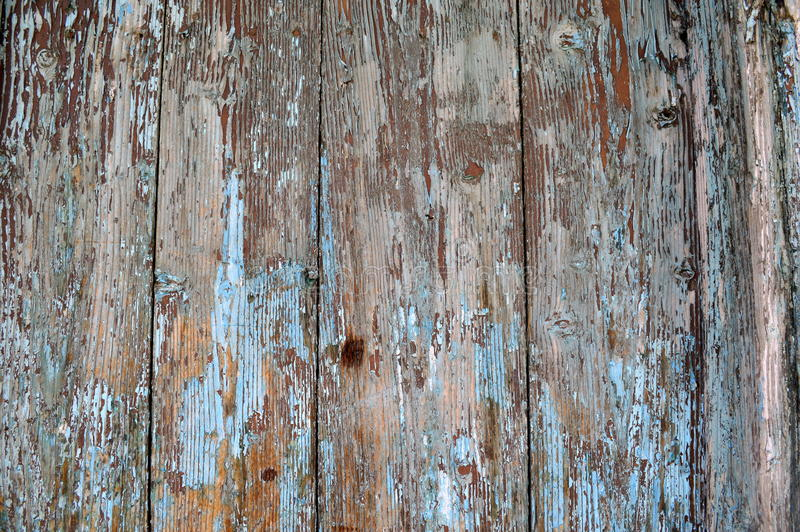 Doorstane oud gepeld van houten blauw tourquoise verf stock foto