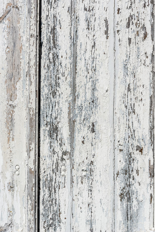 Doorstane witte houten achtergrond met afgebroken verf en schil stock afbeeldingen