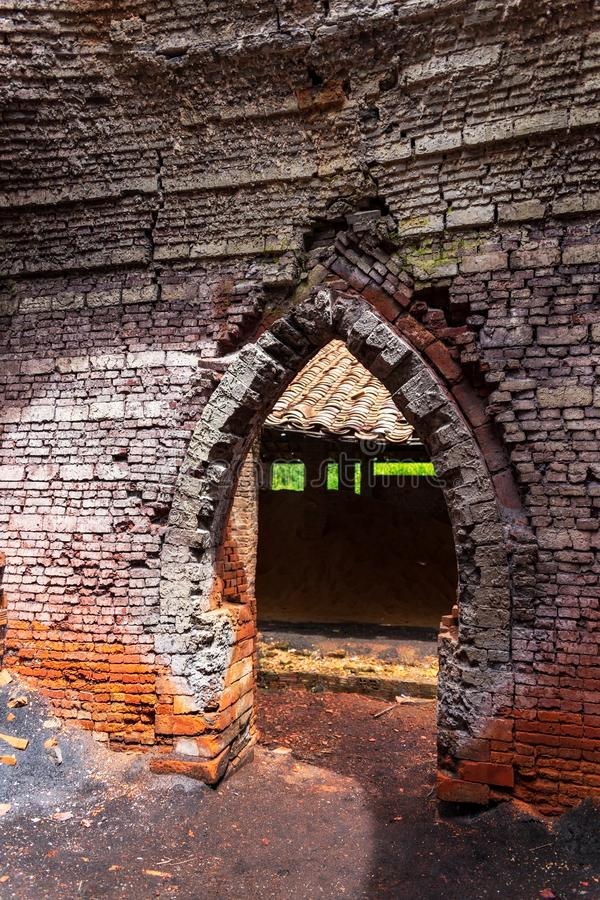 The doorway of a brick kiln from the inside in a brick factory in Ben Tre, Mekong delta region, Vietnam. The doorway of a brick kiln shot from the inside in a stock photography