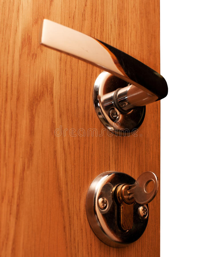 Doorway with key. Wooden doorway with shiny keyhole, key inserted stock images