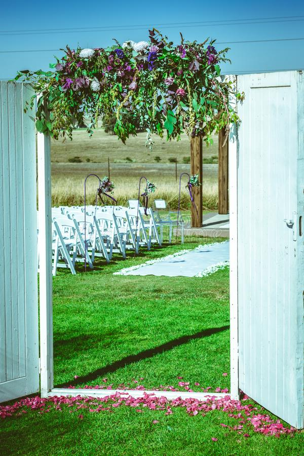Doorway to the wedding ceremony with hanging flowers royalty free stock photos