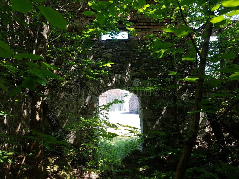Doorway to enlightment. Inside an old destroyed mill outside my village stock photos