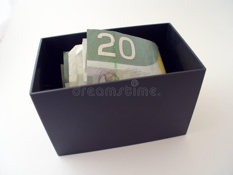 Doos met Geld stock foto