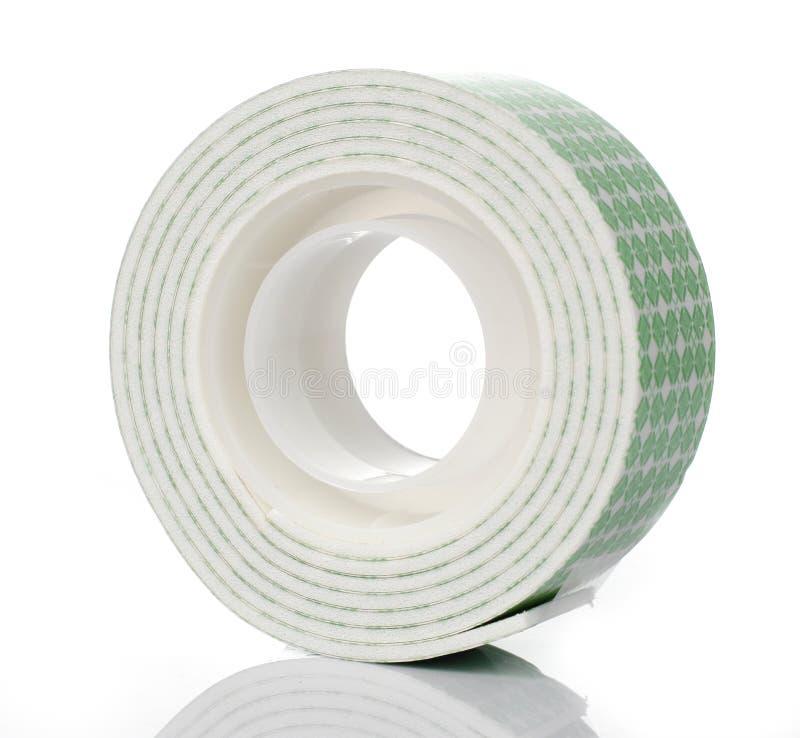Doppeltes Seitenschaum-Band auf weißem Hintergrund stockbild