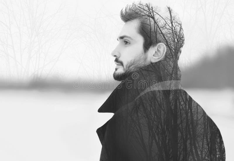 Doppia esposizione dell'uomo barbuto elegante bello nel profilo immagine stock libera da diritti