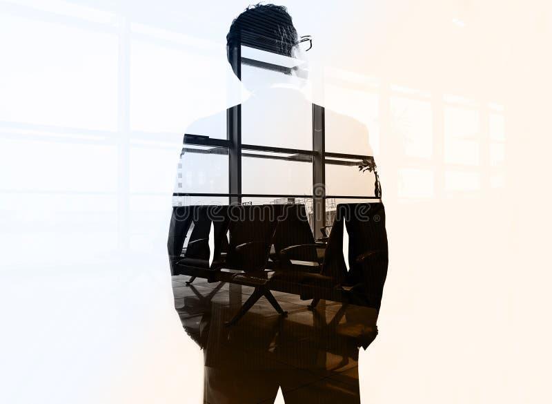 Doppia esposizione dell'uomo d'affari fotografie stock libere da diritti