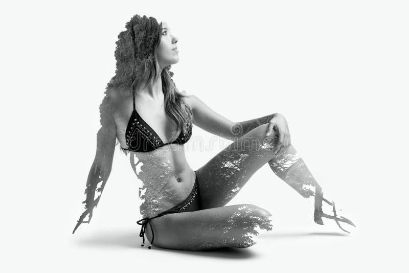 Doppia esposizione di bella donna caucasica fotografia stock
