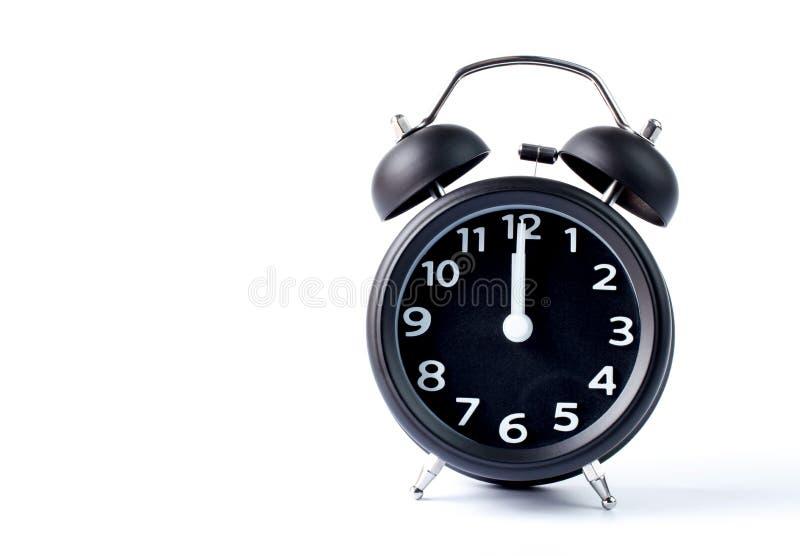 Doppia sveglia nera della campana su fondo bianco fotografia stock
