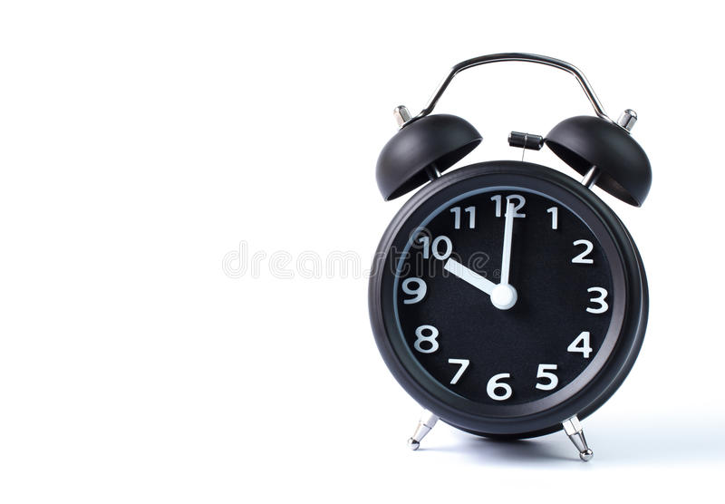 Doppia sveglia nera della campana su fondo bianco fotografie stock
