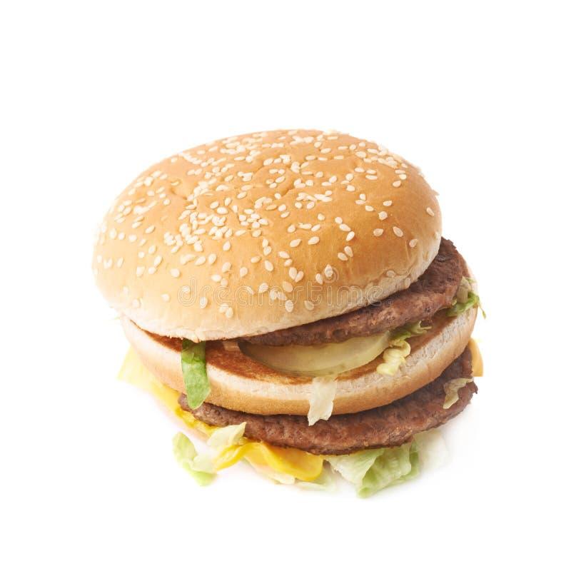 Doppio hamburger con lattuga isolata immagini stock libere da diritti