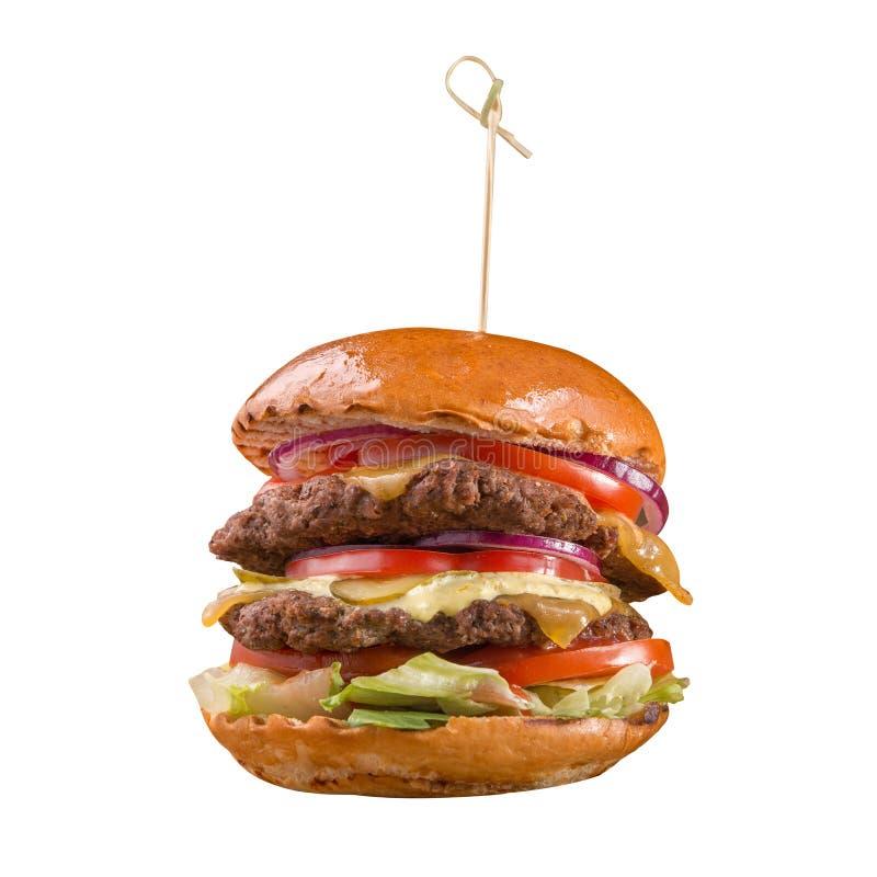 Doppio hamburger del manzo isolato su fondo bianco fotografia stock libera da diritti