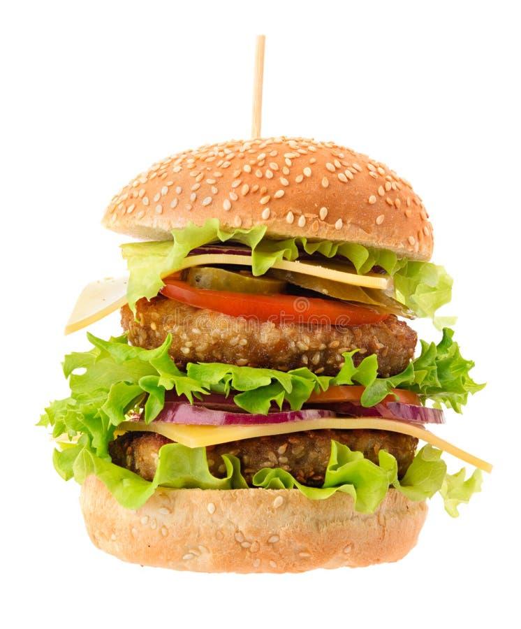 Doppio hamburger delizioso su bianco immagine stock