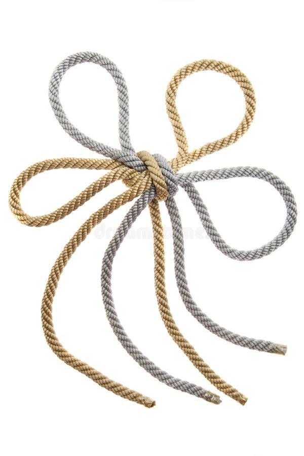 Doppio nodo su una corda dell'argento e dell'oro immagini stock