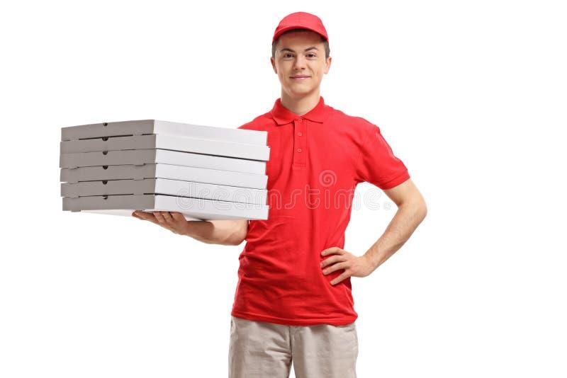 Doręczeniowej chłopiec mienia pizzy pudełka zdjęcia royalty free