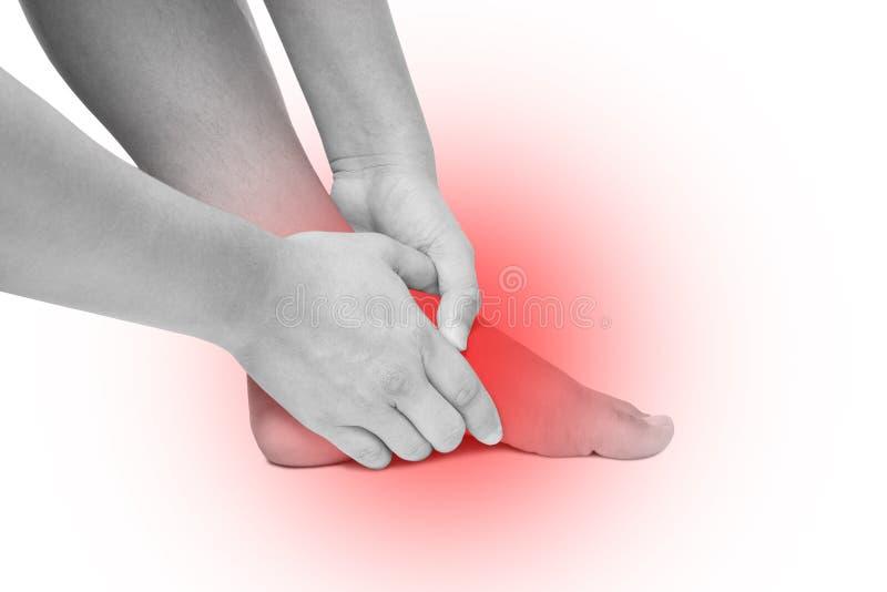 A dor aguda na sola, sola do pé do pé da massagem da mão isolou o branco imagem de stock