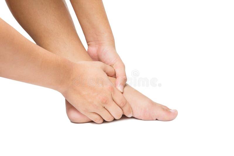 Dor aguda no pé branco do pé da massagem da mão fotografia de stock royalty free