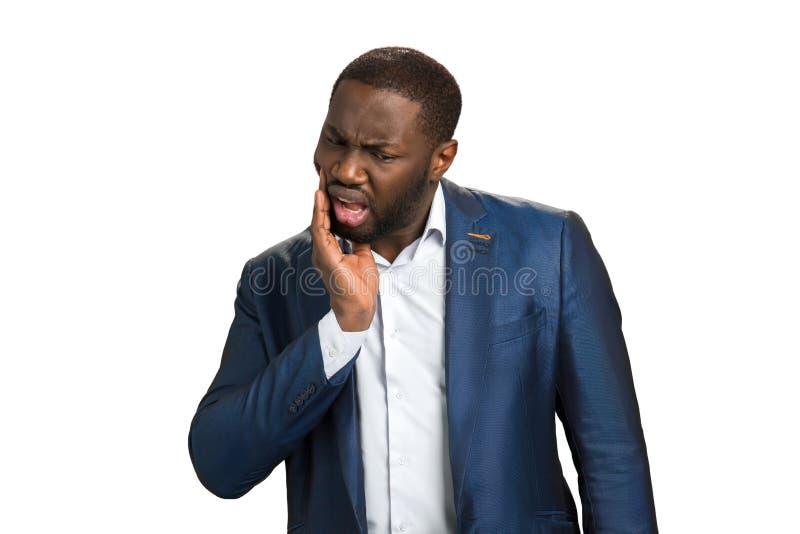 Dor de dente afro-americana do sentimento do homem de negócios fotos de stock royalty free