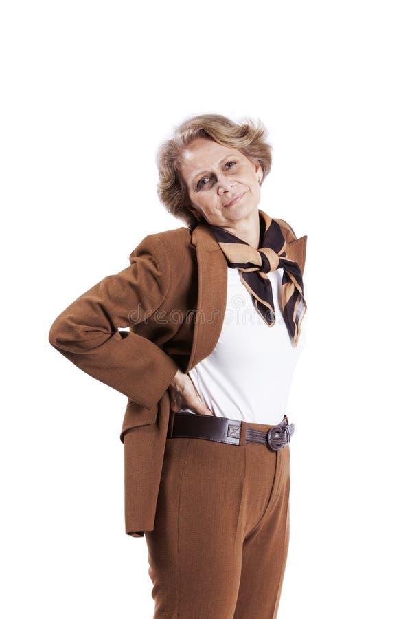 Dor traseira da mulher sênior fotos de stock