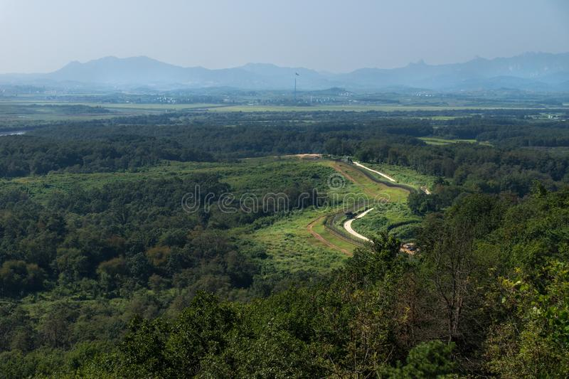 Dora Observatory, DMZ, Korea - September 8 2017: View to North Korea Propaganda village or Peace Village at Korean Demilitarized Z. One, with pole and flag of stock images