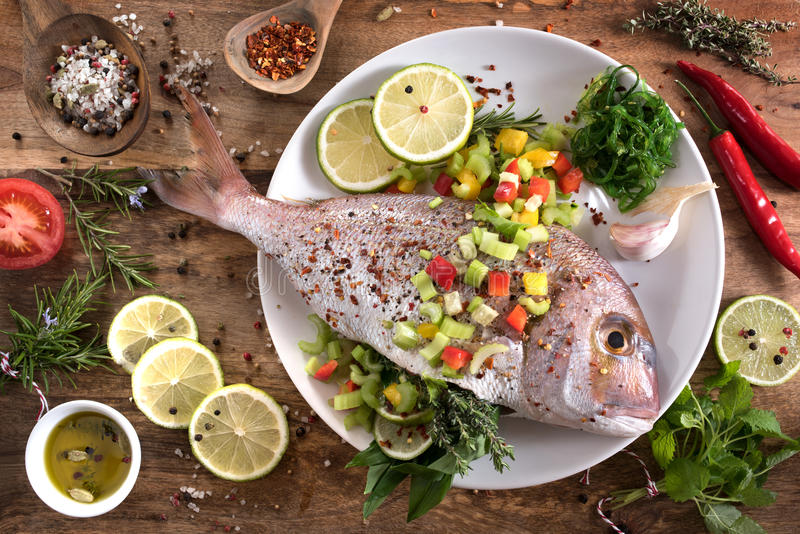 Dorade with herbs filling. Dorade fish with herbs filling and gazpacho for grilling stock photo