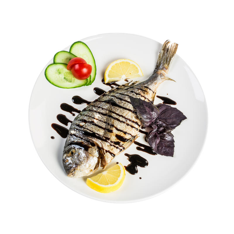 Dorado roast fish on the white royalty free stock photos