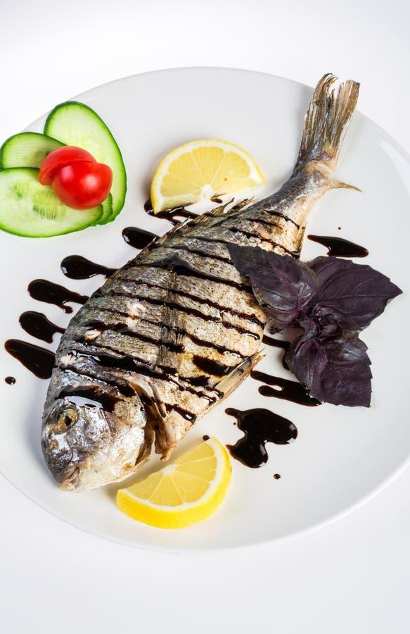 Dorado roast fish on the white stock photography