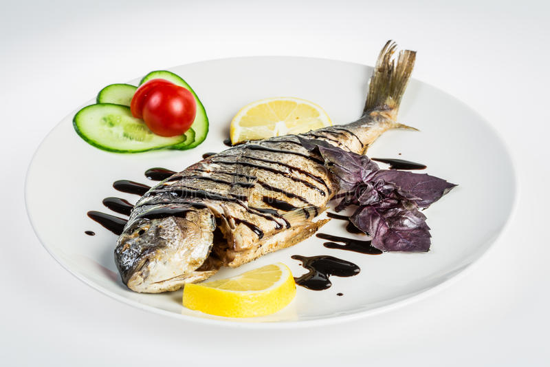 Dorado roast fish on the white stock images