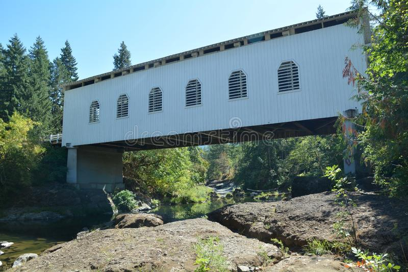 Dorena Covered Bridge in Lane Co., Oregon. The Dorena Bridge is a covered bridge near Dorena in Lane County, Oregon in the United States. It is listed on the stock image