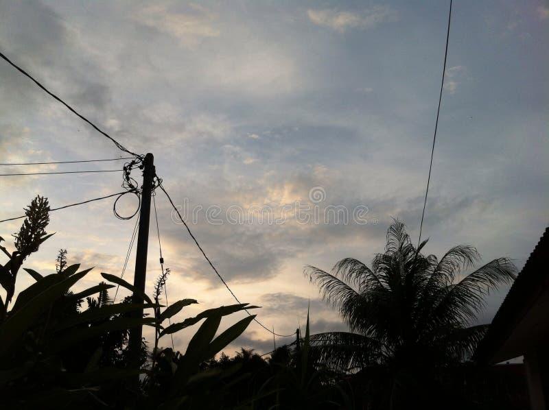 Dorf-Sonnenuntergang lizenzfreies stockfoto