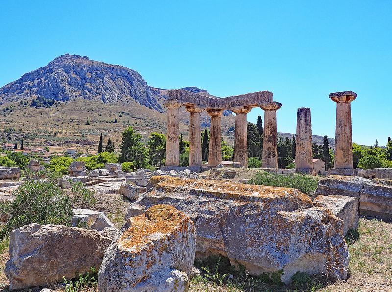 Temple of Apollo at the Archaeological Park of Ancient Corinth in Greece. The doric columns of the Temple of Apollo at the site of Ancient Corinth in Greece and stock images