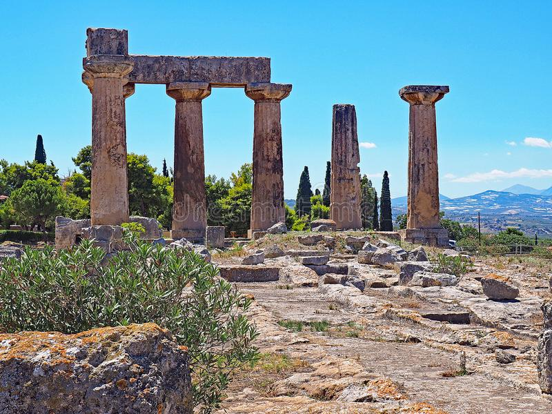 Temple of Apollo at the Archaeological Park of Ancient Corinth in Greece. The doric columns of the Temple of Apollo at the site of Ancient Corinth in Greece stock photos