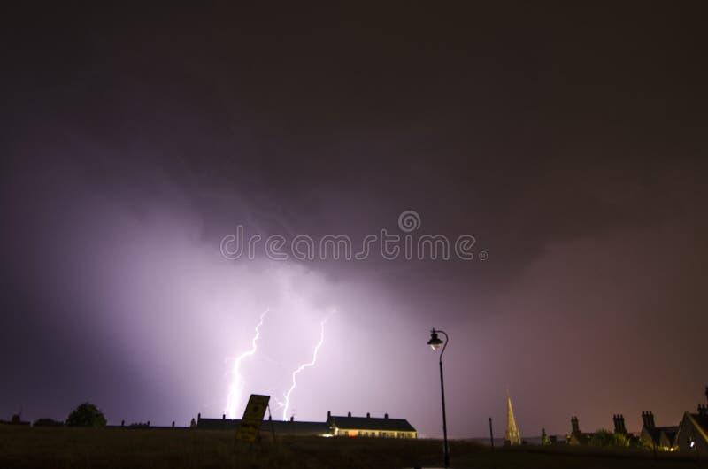 Dorking, UK- 19 July, 2017 Lightning storm over Dorking town. stock photos