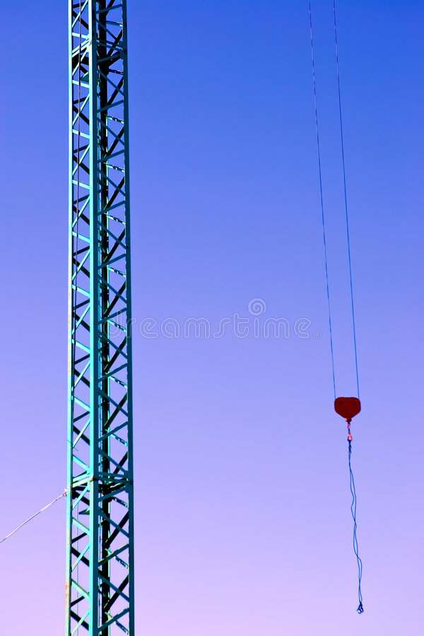 Dormant crane at the end of a busy day stock images