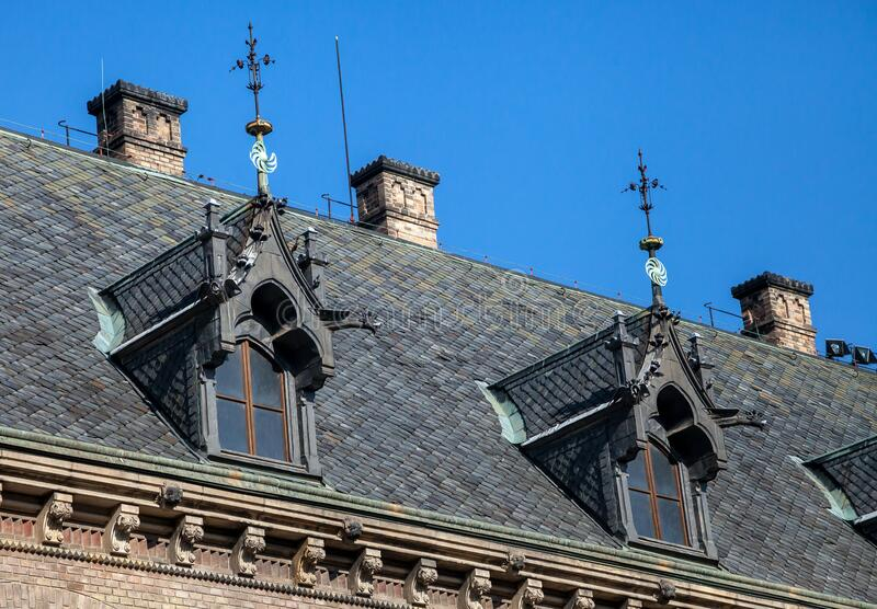 Dormer windows on the roof of gothic building royalty free stock photography