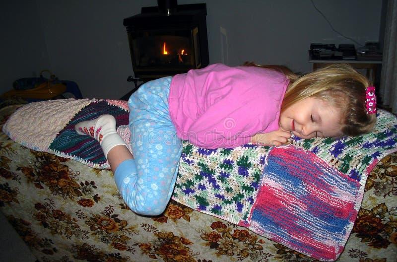 Dormida no sofá imagem de stock royalty free