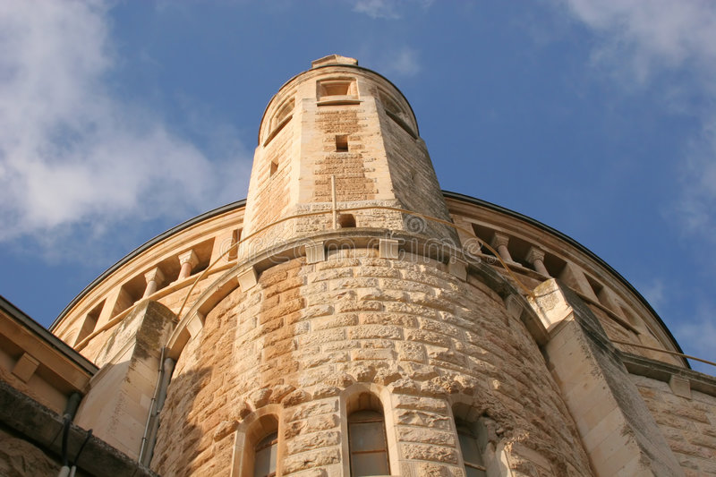 Dormition Abby Corner Tower. Dormition Abby (Benedictine Basilica of the Dormition) in Jerusalem. The Dormition Abbey is a massive structure, just outside the royalty free stock image