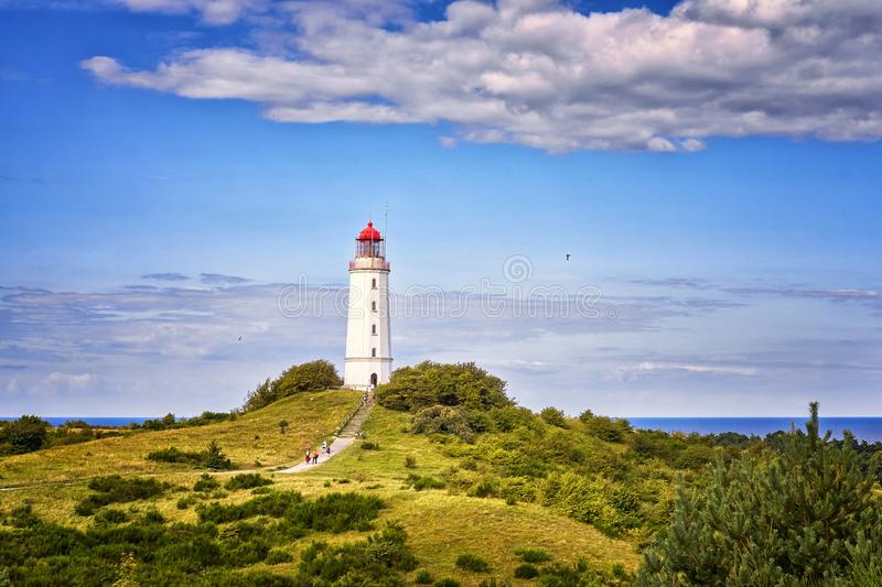 Dornbusch Lighthouse located in the north of the German island of Hiddensee in the Baltic Sea at sunny weather. Architecture, blue, building, coast, europe royalty free stock photos