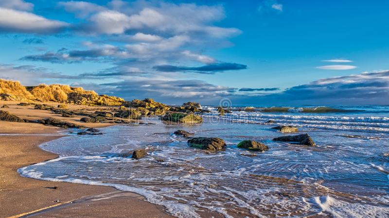 Dornoch beach with the tide coming in royalty free stock photography
