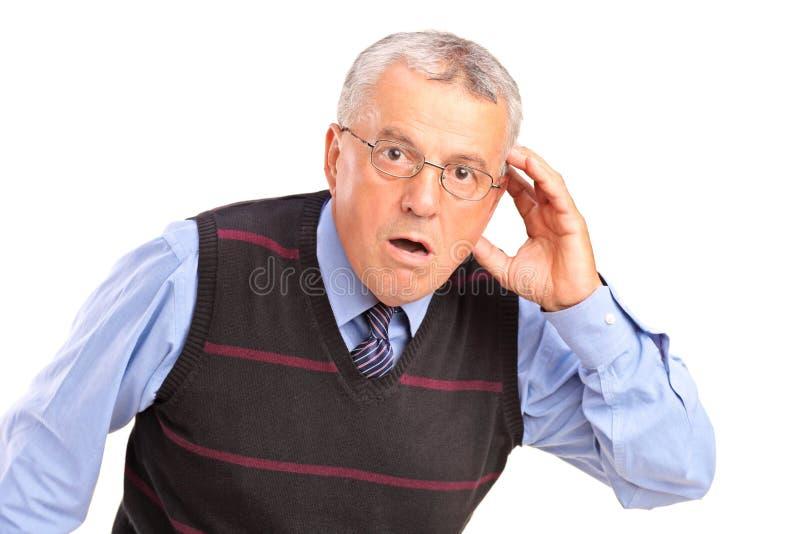 Dorośleć mężczyzna target280_1_ jego głowę i target282_0_ co zdjęcie stock