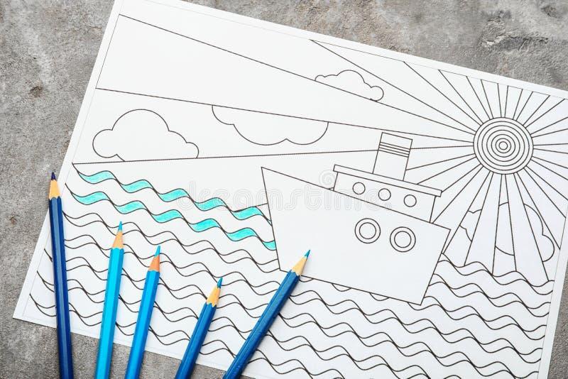 Dorosły anty stres kolorystyki obrazek i ołówki na popielatym tle, odgórny widok zdjęcie stock