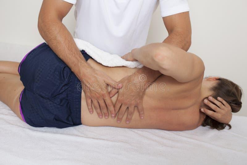 Dorsal manipulation. Chiropractic care applying dorsal manipulation royalty free stock photo