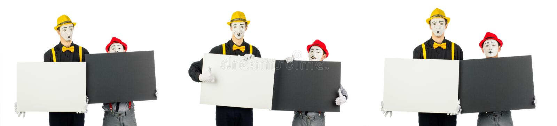 Dos actores, pantomimas, llevan a cabo las formas vacías para el texto Aislado en blanco fotografía de archivo libre de regalías