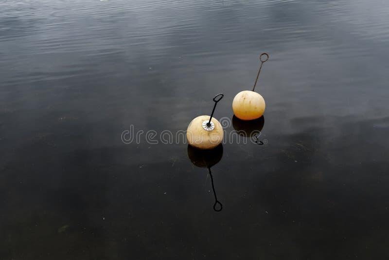Dos aparejos de pesca en el agua imágenes de archivo libres de regalías