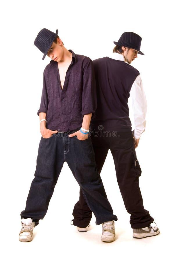 Dos bailarines que se colocan de nuevo a la parte posterior imagen de archivo